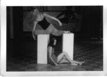 Rajni and Jill rest balance around a plinth, photo by Todd Carroll