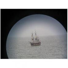 image from Point and Place book of a boat seen through a circle